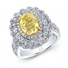 WHITE AND YELLOW GOLD VINTAGE FANCY YELLOW DIAMOND ENGAGEMENT RING